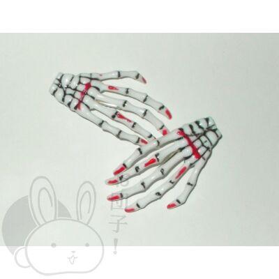 Csontváz kéz hajcsat véres fehér