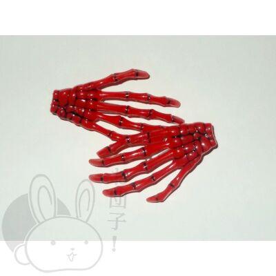 Csontváz kéz hajcsat piros